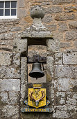Bell and coat of arms at Cowdor Castle.