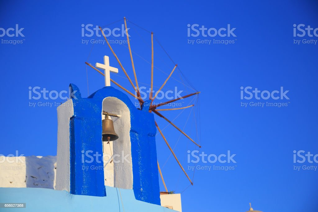 Bell and cross in Oia, Santorini stock photo