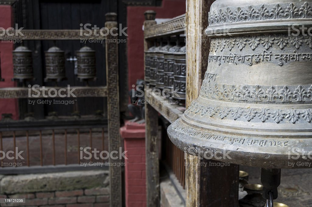 bell and prayer wheels in nepal royalty-free stock photo