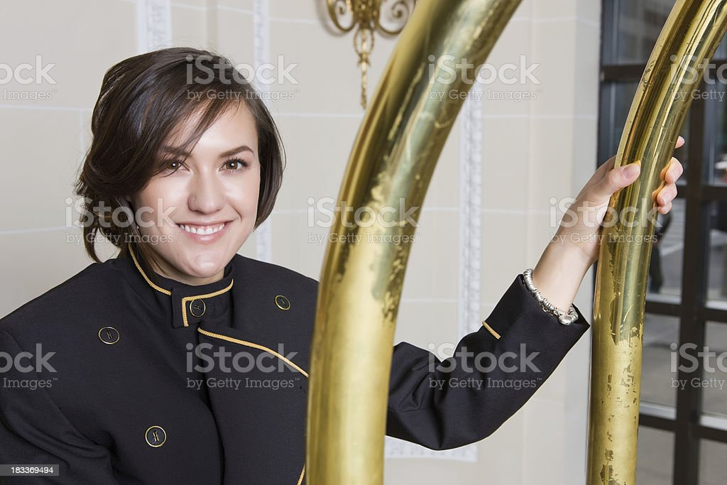 Bell Hop Stands With Cart In Luxury Hotel royalty-free stock photo