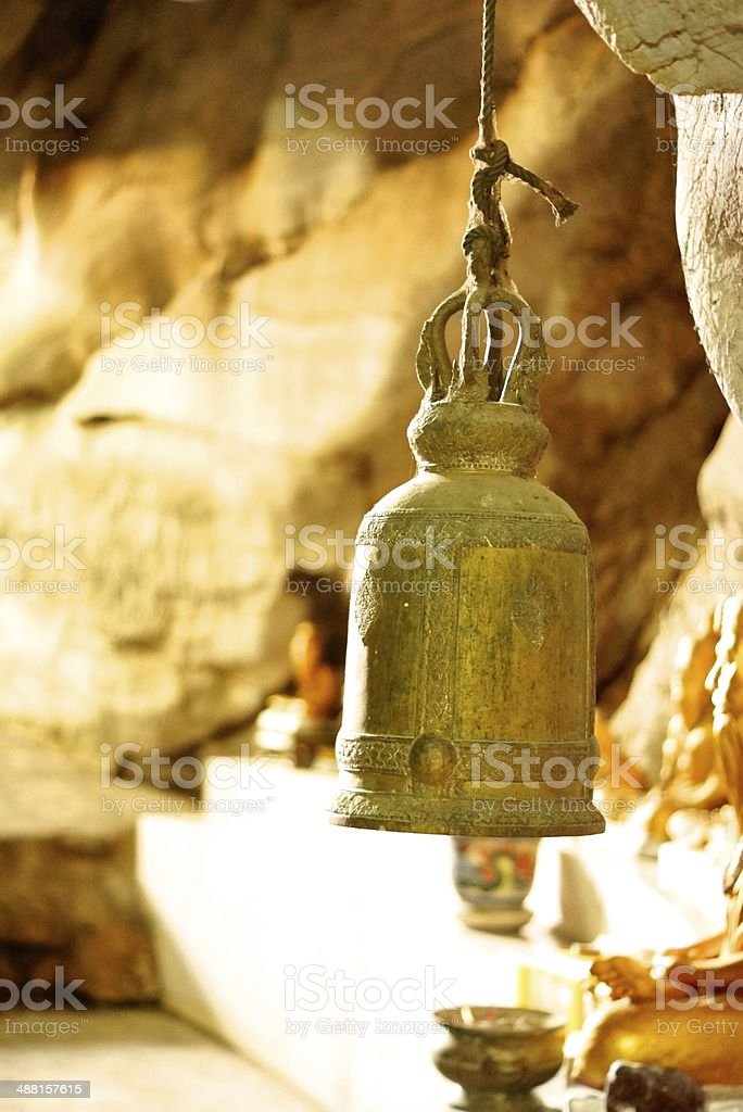 bell in the cave stock photo