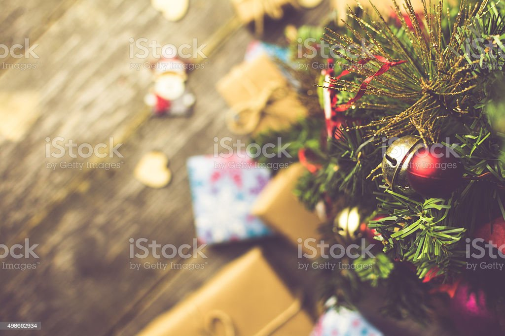 Bell on a Christmas Tree With Wooden Background