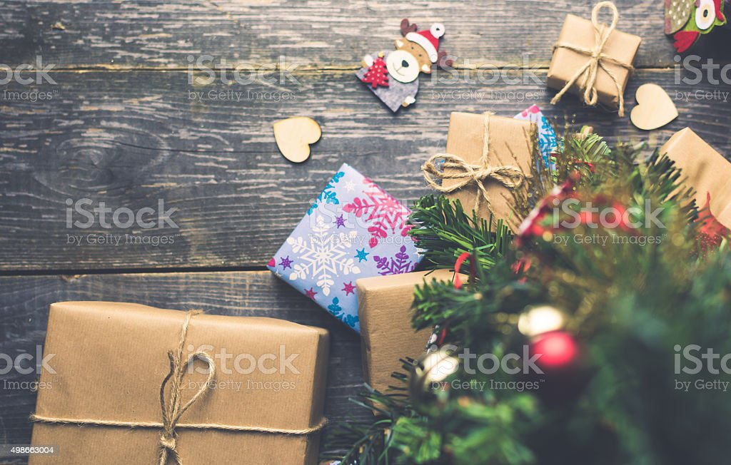 Bell on a Christmas Tree With Gifts stock photo