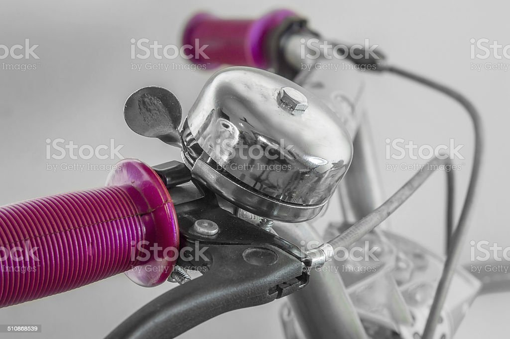 Bell on handlebar of cycle stock photo