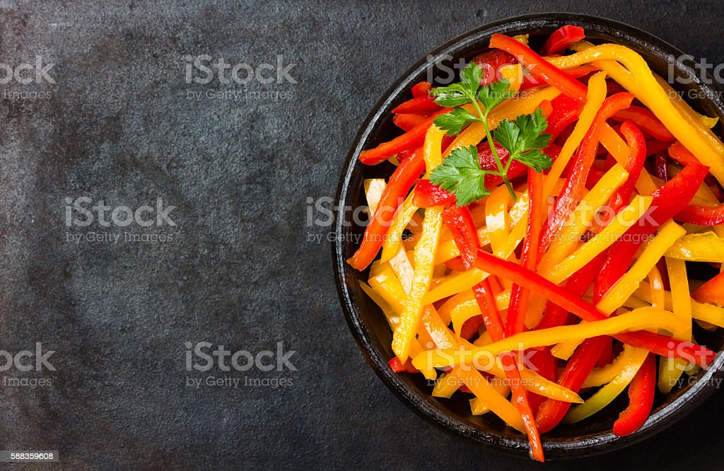 Bell pepper salad on black background. Top view stock photo