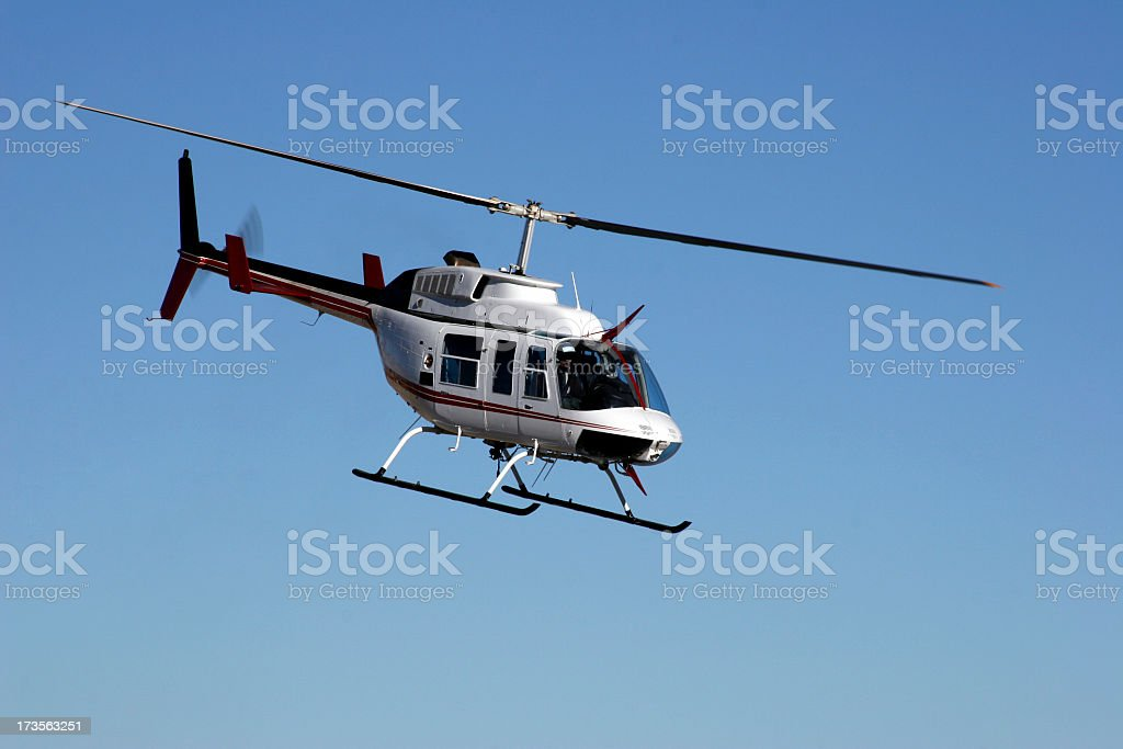 A Bell Ranger helicopter flying on a clear day royalty-free stock photo