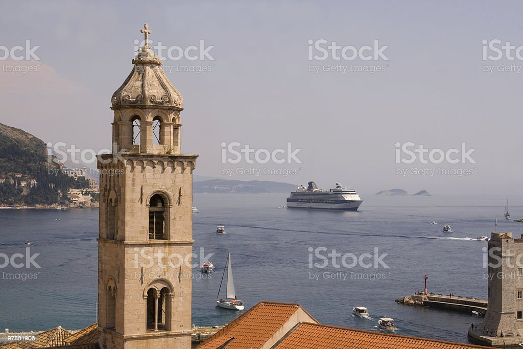 Bell tower and cruise ship royalty-free stock photo