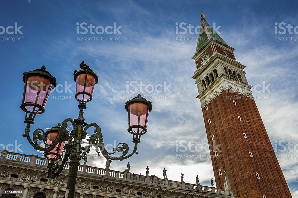 Bell tower and street lamp on St. Mark's Square, Venice royalty-free stock photo