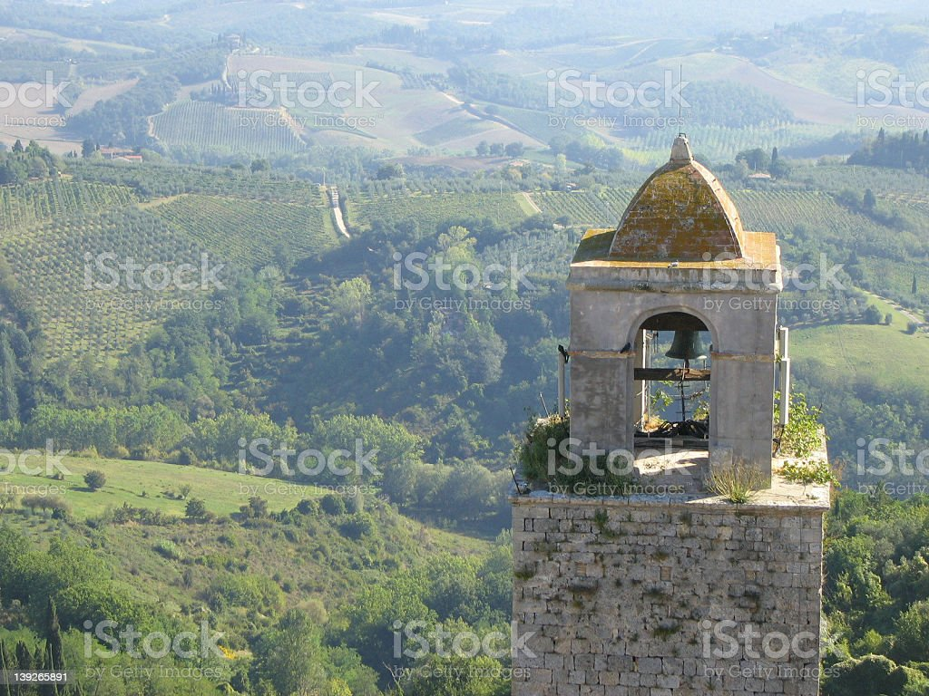 Bell Tower and Tuscan Landscape in San Gimignano royalty-free stock photo