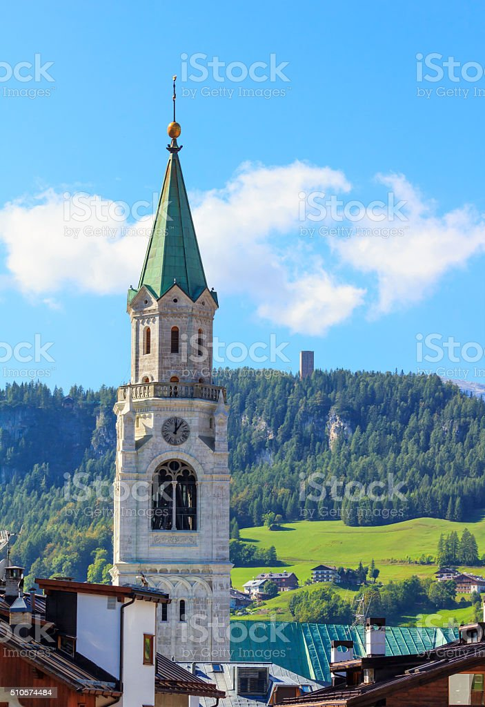 Bell tower in Cortina d'Ampezzo, Italy - vertical stock photo