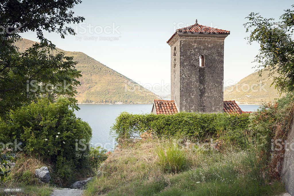 Bell tower of ancient Orthodox Church. Perast. Montenegro stock photo