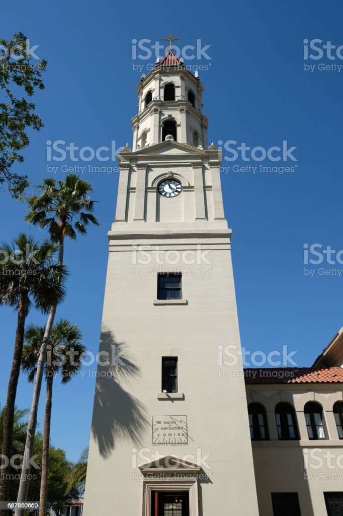Bell tower of the Cathedral Basilica of St. Augustine in St Augustine, Florida. Historic 18th cathedral, stucco cladding and terra cotta tiled roof, Spanish Mission meets Neoclassical architecture. stock photo