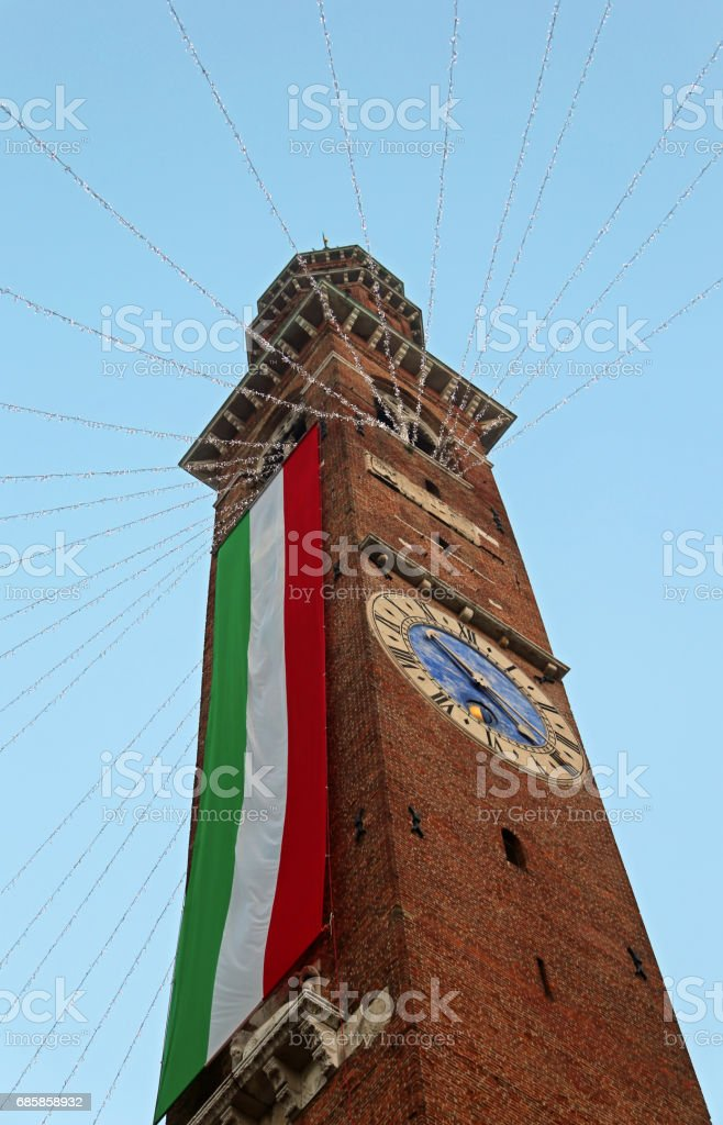 bell tower with enormous Italian flag in  Vicenza City in Northern Italy stock photo