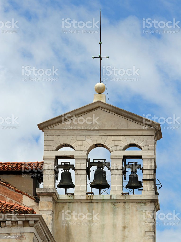 bell tower with three bell in a ancient church stock photo