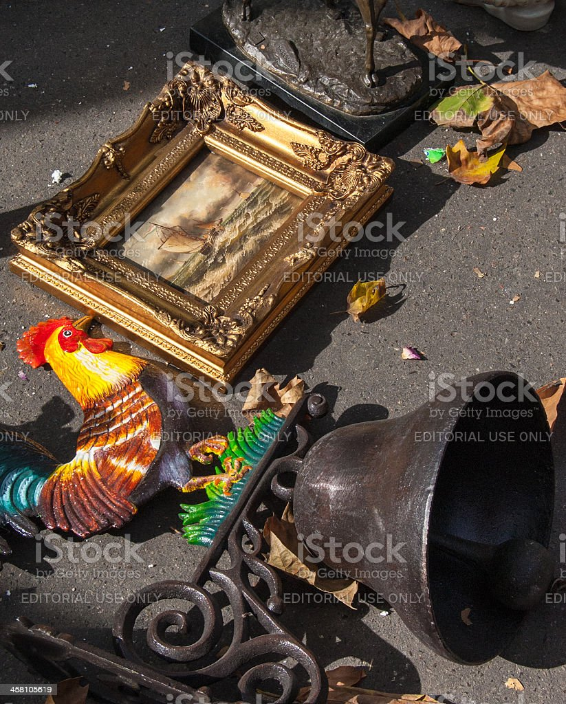 Bell with colourful cock and seascape at flea market. stock photo