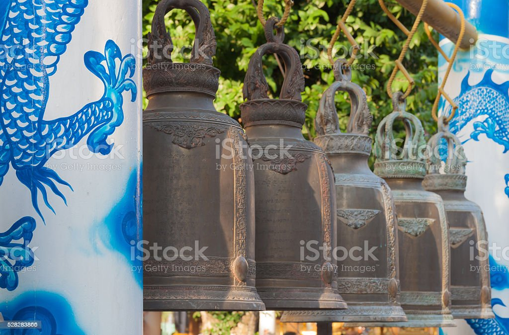 Bell with dragon pillar in belfry at thai temple royalty-free stock photo