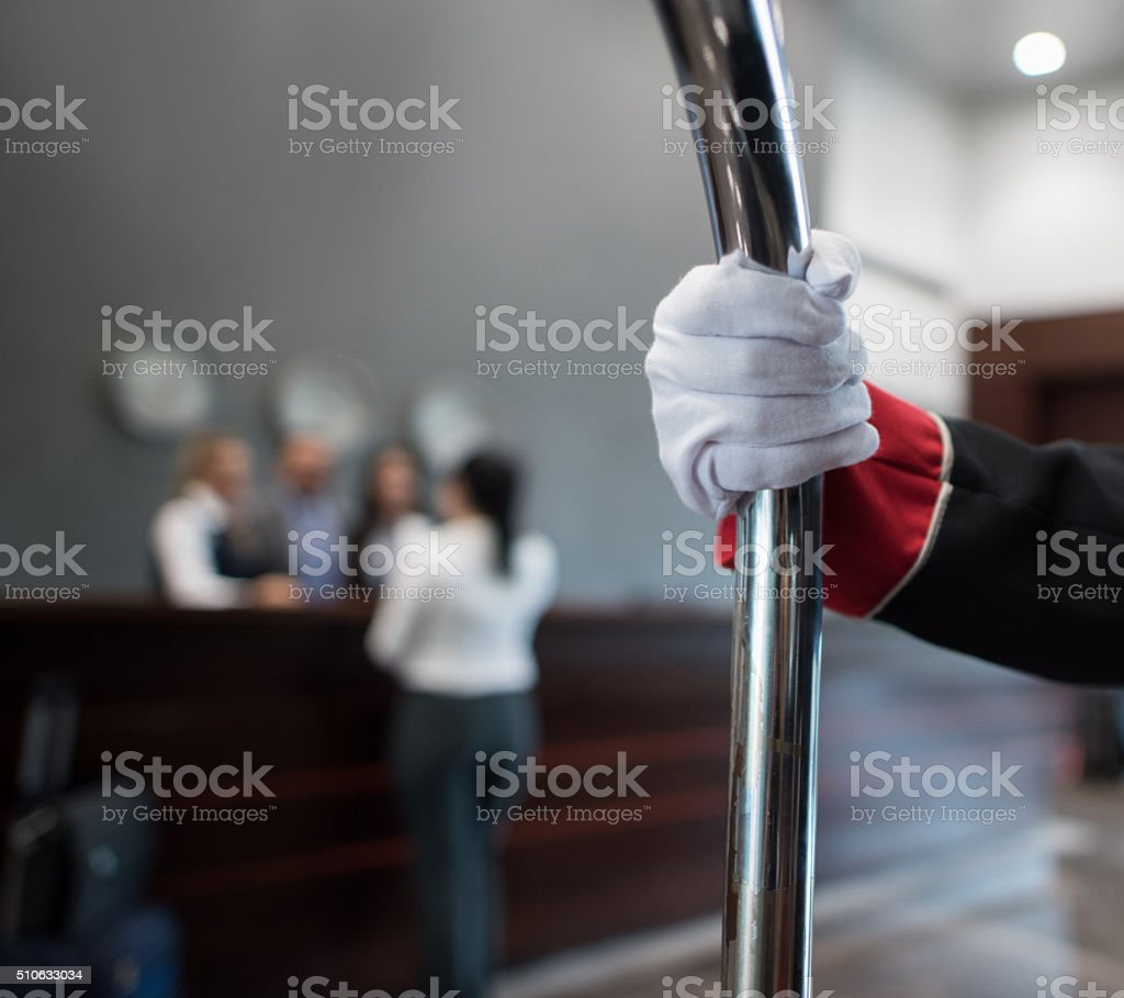 Bellboy carrying bags at the hotel stock photo