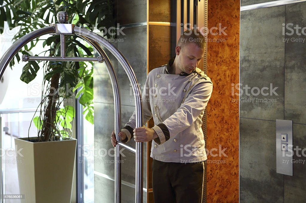 Bellboy going into elevator. royalty-free stock photo