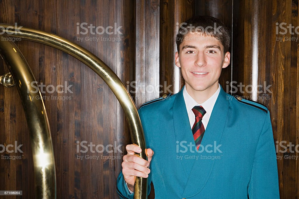 Bellboy holding railing stock photo