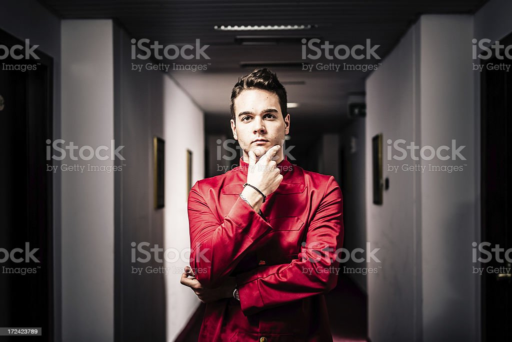 Bellboy in Hotel Corridor, Solving Problems royalty-free stock photo