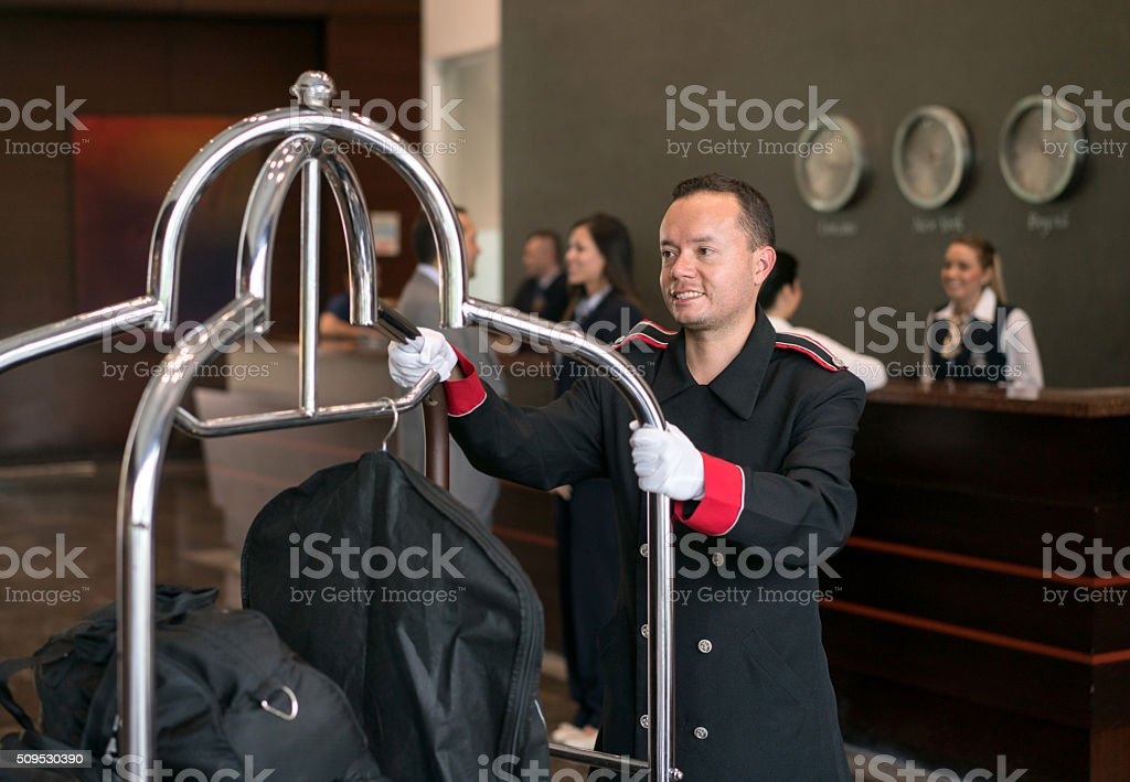 Bellboy working at a hotel stock photo