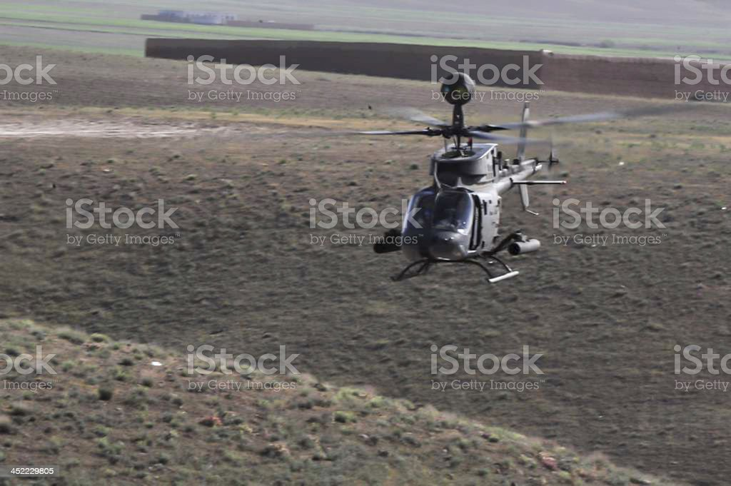 Belle helicopter hovering low stock photo