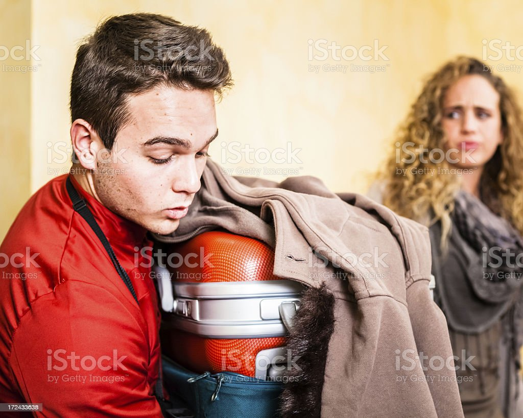 Bellhop Moving Heavy Luggage royalty-free stock photo