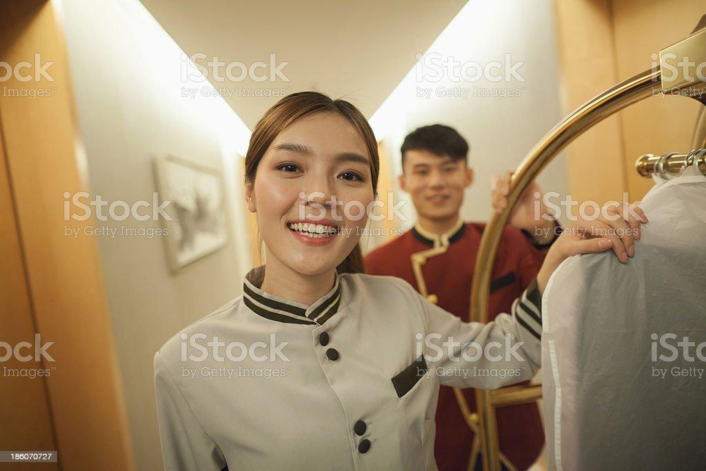 Bellhops in the doorway smiling, portrait stock photo