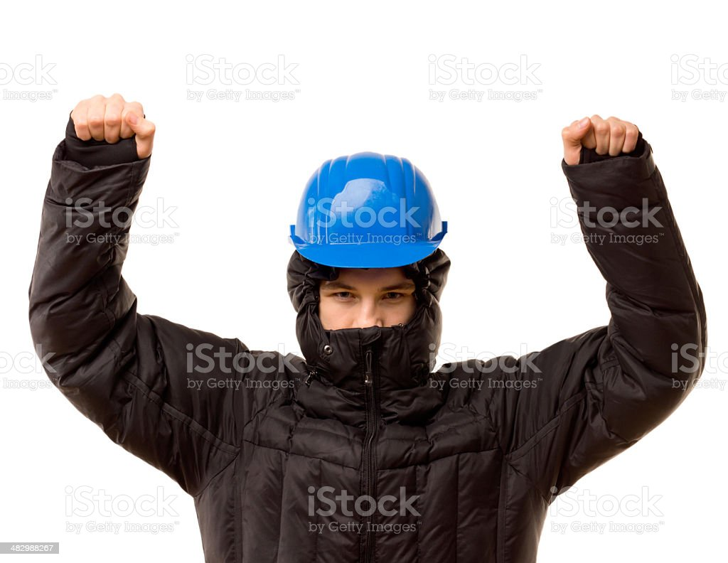 Belligerent young thug raising his arms stock photo
