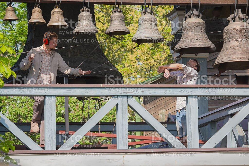 Bell-ringers play on the set of bells. Kiev, Ukraine stock photo