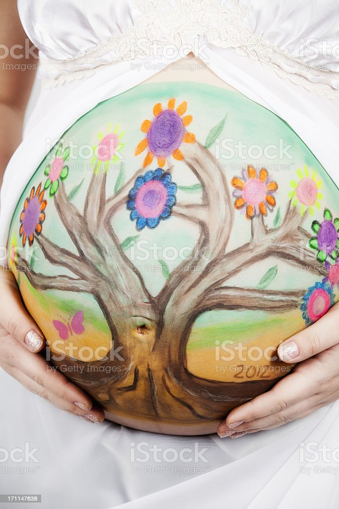 Belly art: painted stomach of an pregnant woman royalty-free stock photo