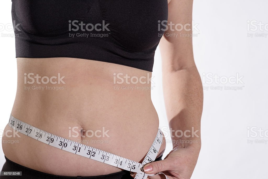 Belly Bulge With Measuring Tape stock photo