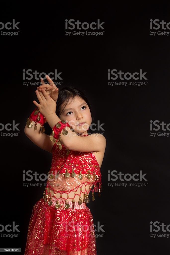 Belly dancer girl with red dress stock photo