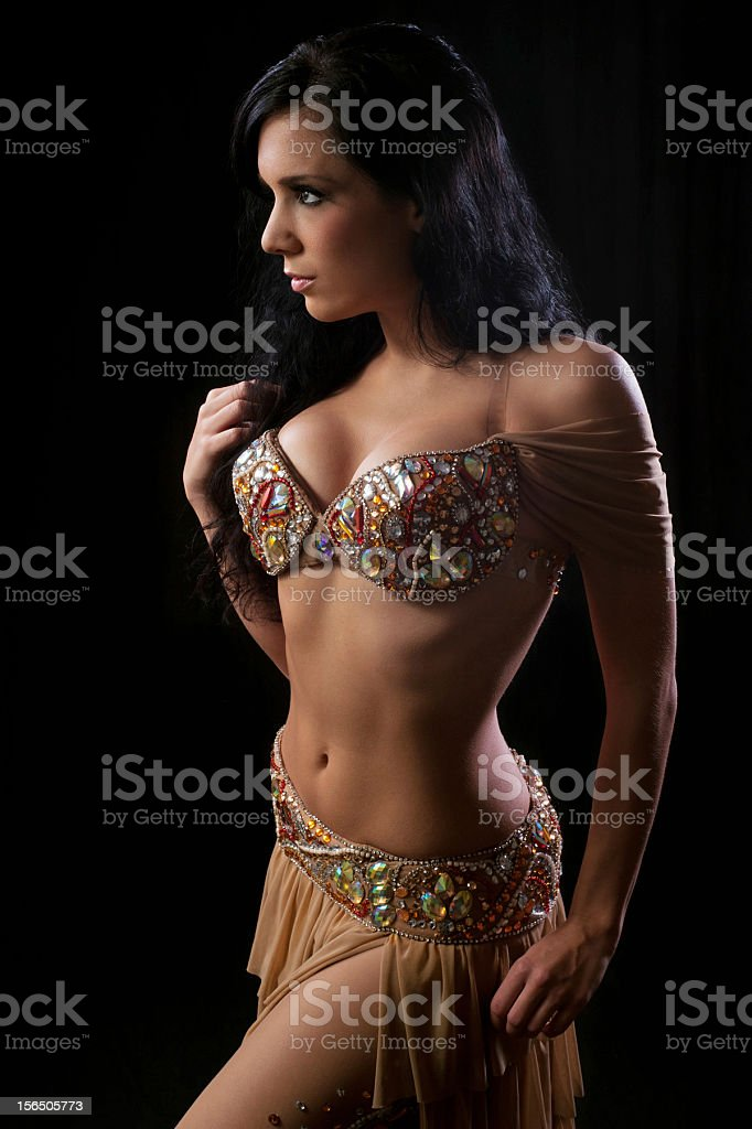 Belly Dancer in a Beige Jeweled Costume royalty-free stock photo