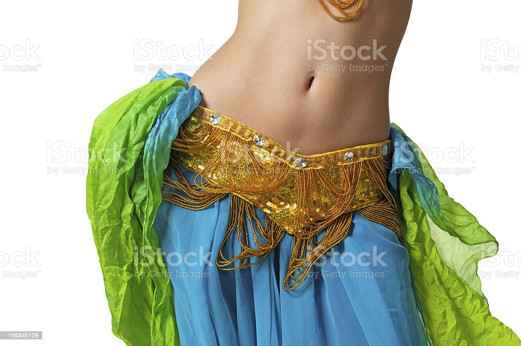 Belly dancer shaking her hips in a bellydance costume royalty-free stock photo