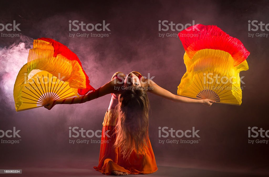 Belly dancer with colorful Fan Veils stock photo