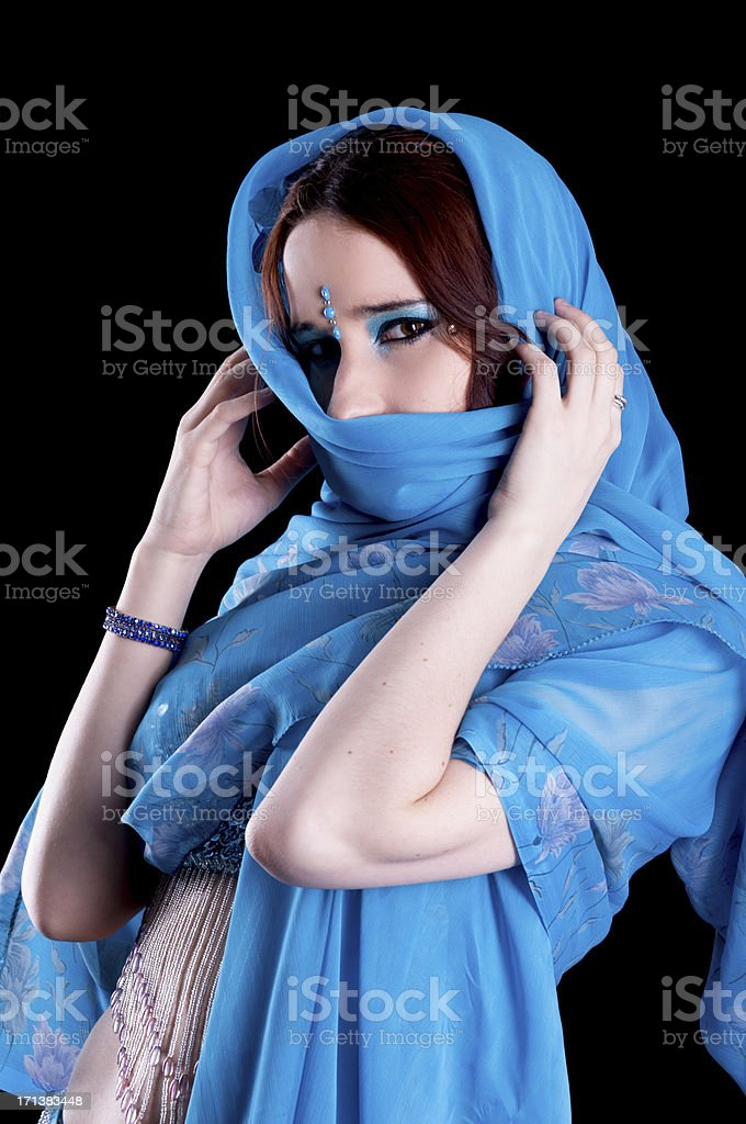 Bellydancer in blue with scarf around head. royalty-free stock photo