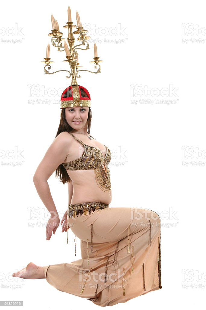 Bellydancer with candelabrum on head royalty-free stock photo