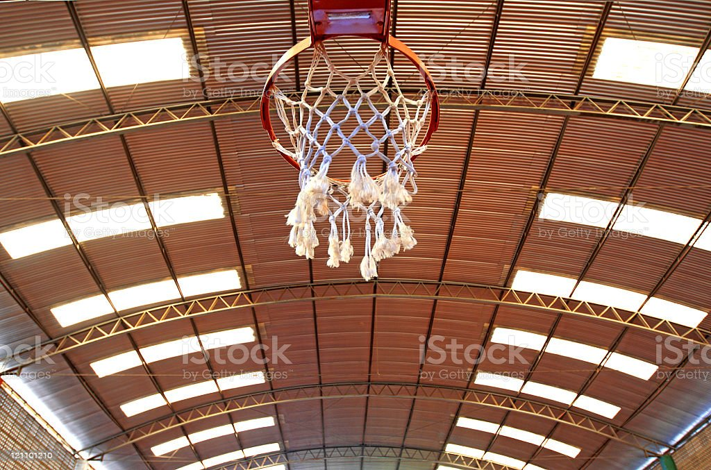 Below the basket on a gymnasium royalty-free stock photo