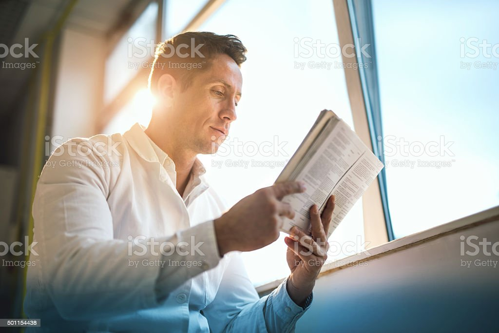 Below view of a male doctor reading medical data. stock photo