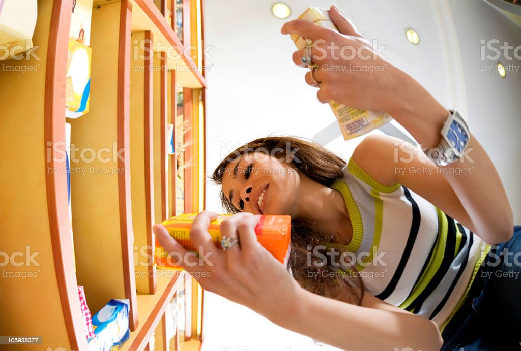 Below view of brunette woman holding two small boxes in hand stock photo