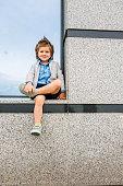 Below view of cute boy relaxing outdoors.