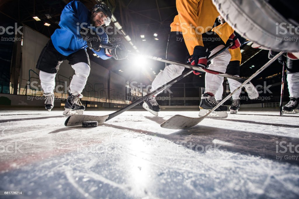 Below view of ice hockey players in action during the match. stock photo