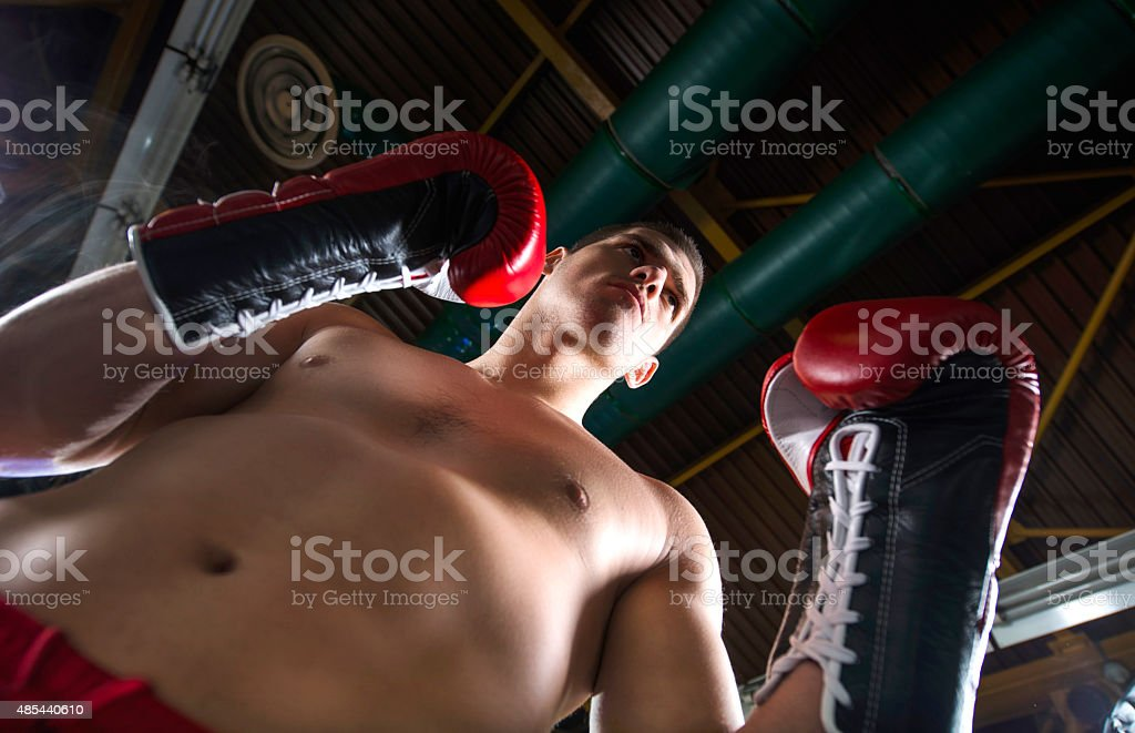 Below view of male boxer in fighting stance. stock photo