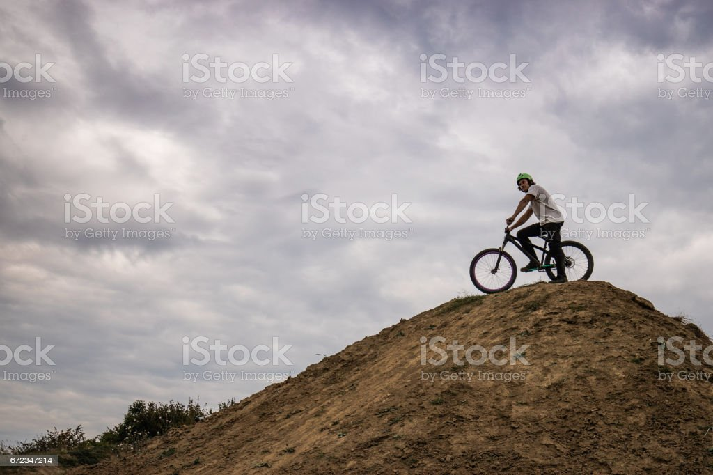Below view of mountain bike cyclist on top of hill. stock photo