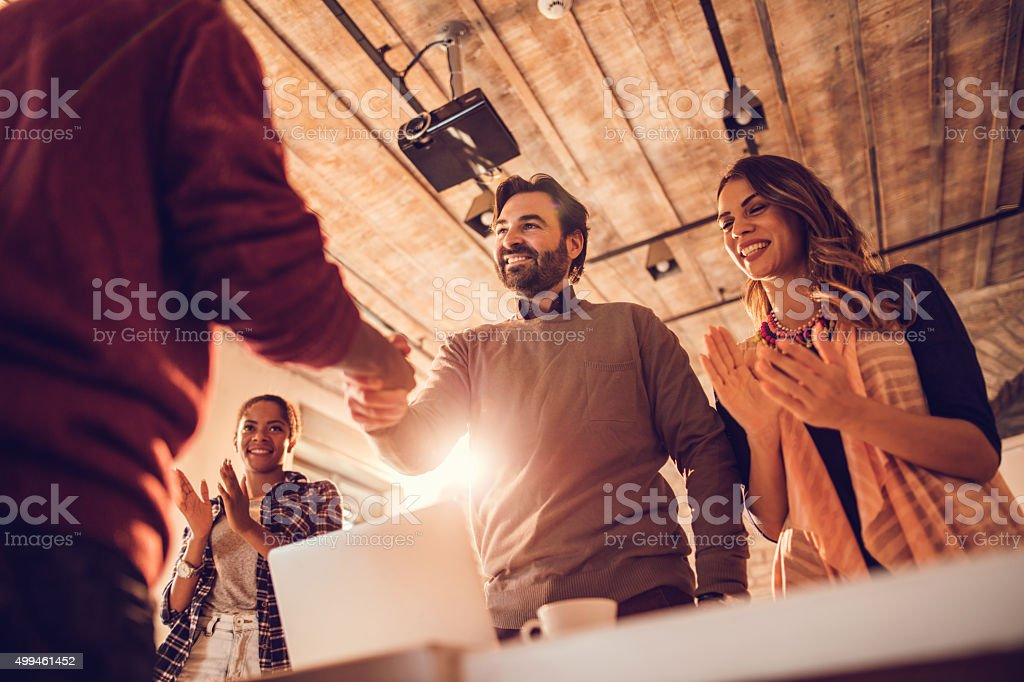 Below view of successful job interview in the office. stock photo