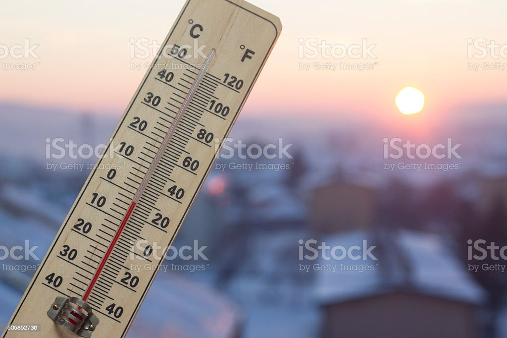 Below Zero degree Celsius temperature in sunset above town stock photo