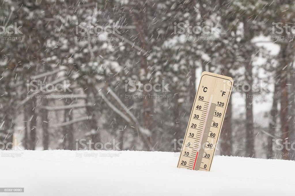Below Zero degree Celsius temperature on mercury thermometer in snowstorm stock photo