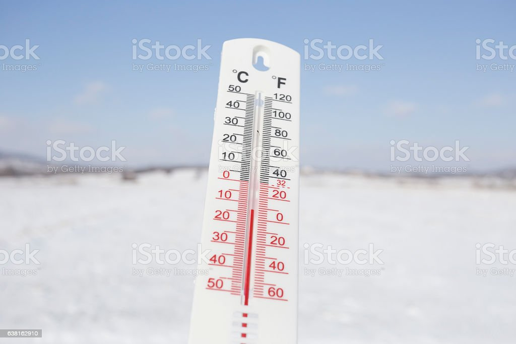 Below Zero degree Celsius temperature outdoor on snowy landscape stock photo