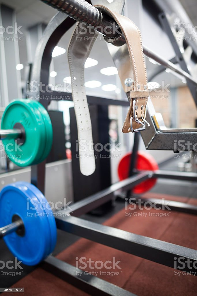 belt and weights for powerlifting stock photo